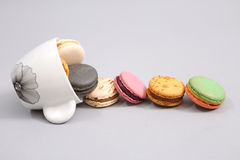 Coffee cup full of macaroon cakes Stock Photos
