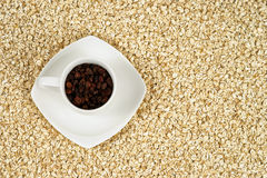 Coffee cup full of raisins with oat flakes royalty free stock photo