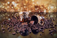 Coffee cup full of roasted coffee beans. Stock Image