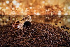 Coffee cup full of roasted coffee beans. Royalty Free Stock Photos