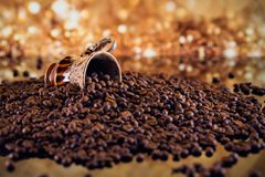 Coffee cup full of roasted coffee beans. Stock Photography