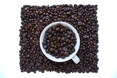 Coffee. A Cup full of coffee on a white background Royalty Free Stock Photography