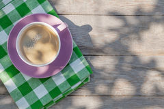 Coffee cup on garden table Royalty Free Stock Image