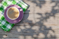 Coffee cup on garden table Royalty Free Stock Photo