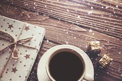 Coffee Cup gift boxes snowflakes on wooden background, Christmas background stock photos