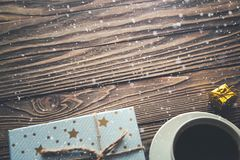 Coffee Cup gift boxes snowflakes on wooden background, Christmas background royalty free stock photography