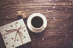 Coffee Cup gift boxes snowflakes on wooden background, Christmas background royalty free stock photo