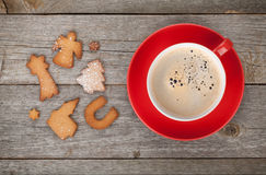 Coffee cup and gingerbread cookies Royalty Free Stock Images