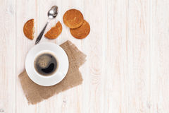Coffee cup, gingerbread cookies and spoon Royalty Free Stock Photo