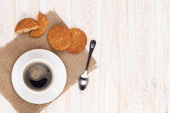 Coffee cup, gingerbread cookies and spoon Royalty Free Stock Image
