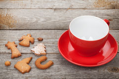 Coffee cup and gingerbread cookies Stock Images