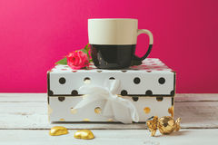 Coffee cup with glamour and elegant feminine objects and rose flower Stock Image