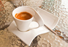 Coffee cup on glass table Royalty Free Stock Photo