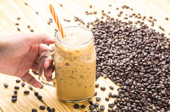 Coffee in a cup glass on table wooden. Coffee in a cup glass stock image