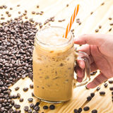 Coffee in a cup glass on table wooden. Coffee in a cup glass Royalty Free Stock Image