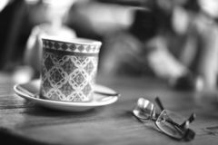 Coffee cup and glasses royalty free stock photography