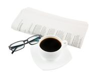 Coffee cup with glasses and newspaper Stock Image