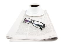 Coffee cup with glasses and newspaper Royalty Free Stock Image