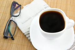 Coffee cup with glasses and newspaper Stock Photography