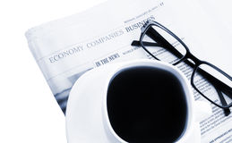 Coffee cup with glasses and newspaper Royalty Free Stock Photos