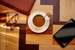Coffee cup with glasses and tablet pc Royalty Free Stock Photography