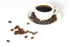 Coffee cup and grain. On white background Royalty Free Stock Image