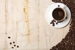 Coffee cup and grain. On old paper background Stock Photos