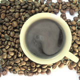 Coffee cup and grain. Close up Stock Photo