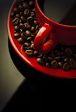 Coffee cup and grain on black. Red coffee cup and grain on black background Stock Images
