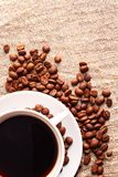 Coffee cup and grain onon a fabric. Still-life Royalty Free Stock Photos
