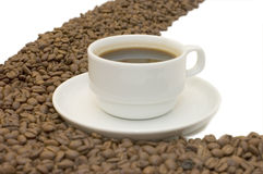 Coffee cup and grain on white Stock Image