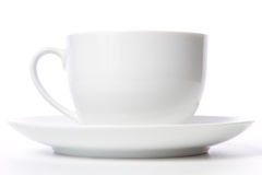 Coffee cup and grain on white Royalty Free Stock Image