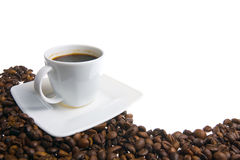 Coffee cup and grain on white background Stock Photography