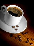 Coffee cup and grains. Cup of black coffee and coffee grain Stock Photos