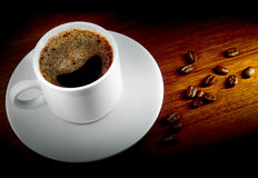 Coffee cup and grains. Cup of black coffee and coffee grain Stock Photo