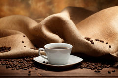 Coffee cup and grains Royalty Free Stock Photos