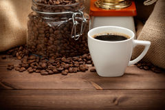 Coffee cup and grains Stock Photography