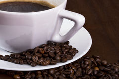 Coffee cup and grains Royalty Free Stock Images