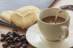 Coffee cup with grains and cookie Stock Images