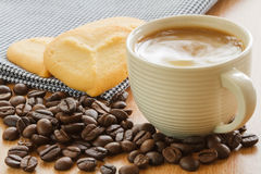 Coffee cup with grains and cookie Royalty Free Stock Photography