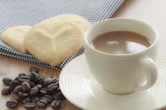 Coffee cup with grains and cookie Royalty Free Stock Photo