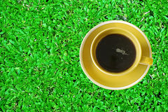 Coffee cup on grass Stock Image