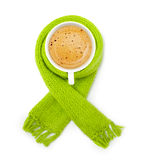 Coffee cup in green scarf Royalty Free Stock Image
