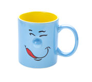 Coffee cup with a grin. Isolated on white background Royalty Free Stock Photos