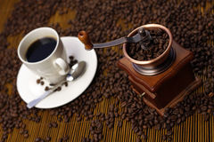 Coffee Cup with Grinder Stock Photo