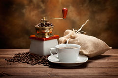 Coffee cup and grinder Stock Photography