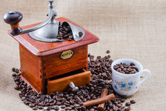 Coffee, cup and grinder. Assembly performed in studio Stock Image