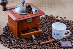 Coffee, cup and grinder. Assembly performed in studio Royalty Free Stock Image