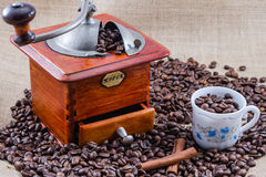 Coffee, cup and grinder. Assembly performed in studio Stock Photography