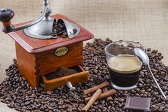 Coffee, cup and grinder. Assembly performed in studio Royalty Free Stock Photos